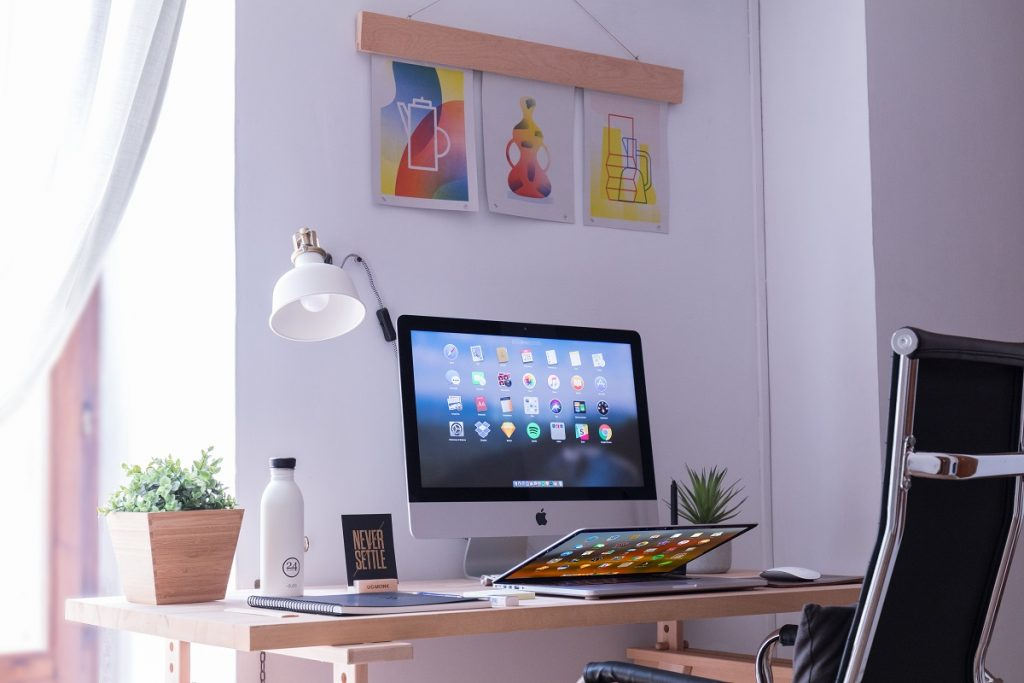 home office with large computer screen