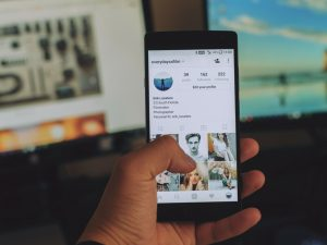 Social Media Drives the Definition of Beauty -mobile phone with Instagram opened