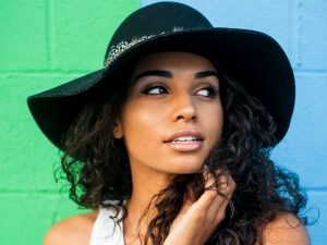 Social Media Drives the Definition of Beauty woman wearing black sunhat