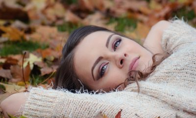 girl lying down in Autumn foliage