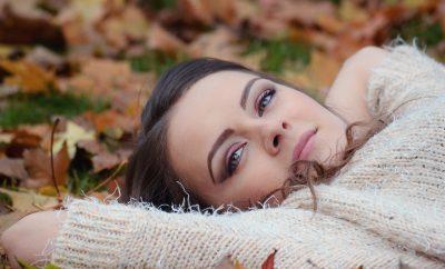 girl lying down in Autumn foliage