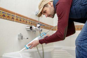 plumber fixing bathroom