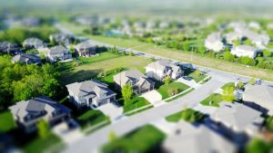 Ariel view of a suburb looking at new houses and green lawns