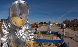 Man in hazard suit in work place