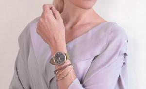 woman front shot showing her wrist watch