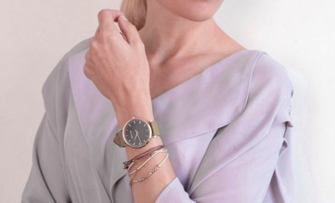 woman front shot showing her wrist watch