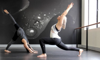 two women in yoga poses
