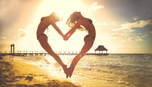 Is your self-image sabotaging your love life? -Two girls making a heart shape with their bodies