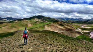 Man alone in a mountain range