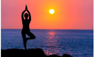 silhouette of woman in a yoga pose at dawn