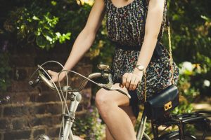 girl in a bicycle in a patterned dress