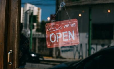 'open' sign on a business window