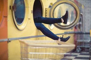 woman leg's hanging out of a drier