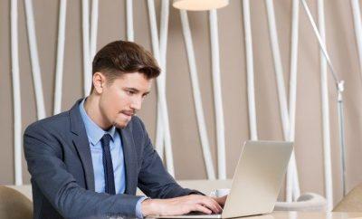 man at desk working at his computer