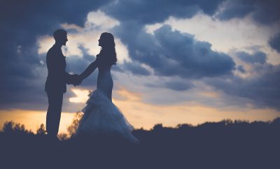 wedding day at dawn with couple facing each other
