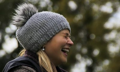 woman wearing a beanie smiling