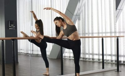 woman stretching on a ballet bar