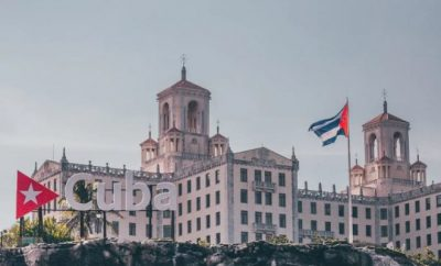 Cuban building with flying flags