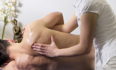 Chiropractor massaging a man's back