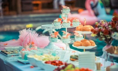 Table laid out with birthday cakes and sweets