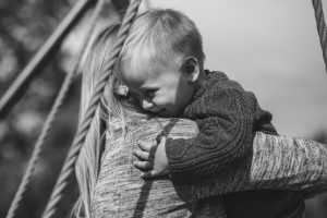 black and white pic of a mother holding her child