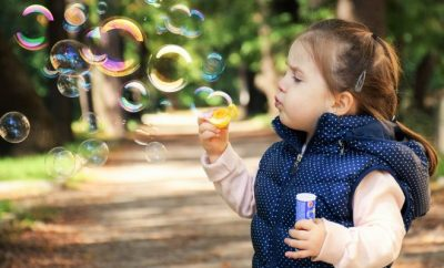 happy child blowing bubbles
