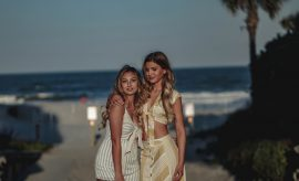 2 blond women, beach, night time