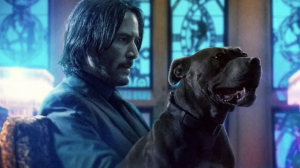 Keanu Reeves and a black dog