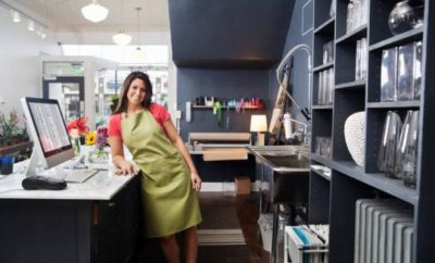 woman in a shop leaning on counter