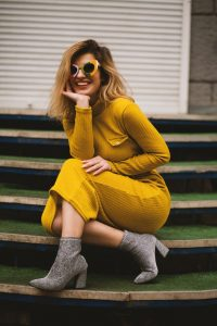 woman in along yellow dress on stairs