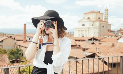 lady with camera on travel