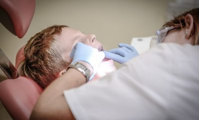 child on a dentist chair.