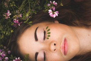 Celebrate Your Skin - 6 Tips for Skin Glow-woman sleeping with pink flowers