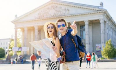 couple with map travelling