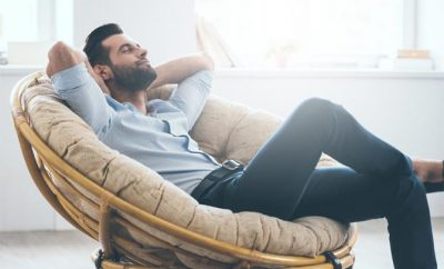 man relaxed sitting on a chair