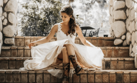 woman in white dress sitting on stone stairs