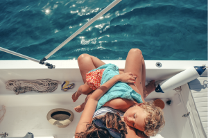child and mother in boat, travel