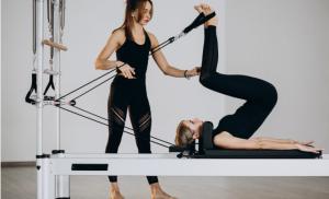Two ladies doing Pilates