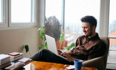 man working remotely from home, technology