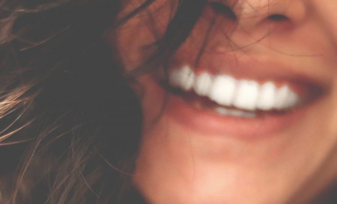 woman smiling confidently