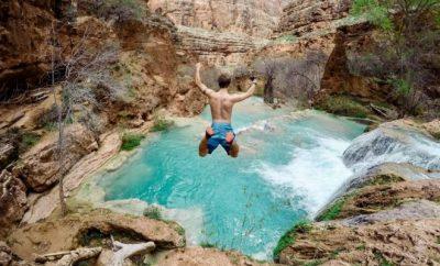 Man diving into a natural pool