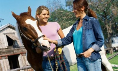 Two women next to a horse, horse,