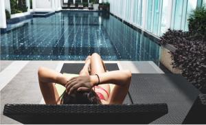 woman suntanning, pool,