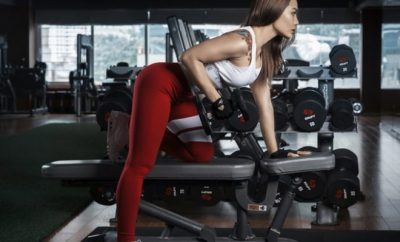 Woman lifting weights at gym