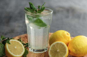A glass with lemonade and lemons