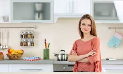 Lady standing in her kitchen
