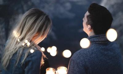 couple lighting lanterns