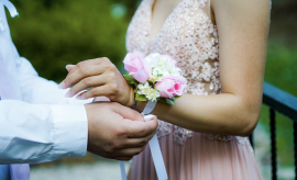 Prom night, Couple putting on corsages