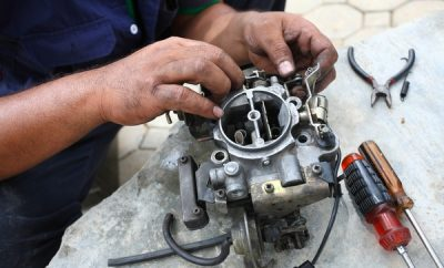 man repairing car Carburettor