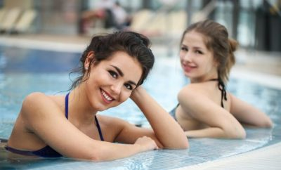 Two women in the pool smiling